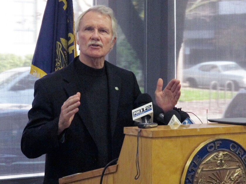 In this file photo, Oregon Gov. John Kitzhaber discusses problems with the website for Cover Oregon, the state's health insurance exchange, during a news conference in Portland.