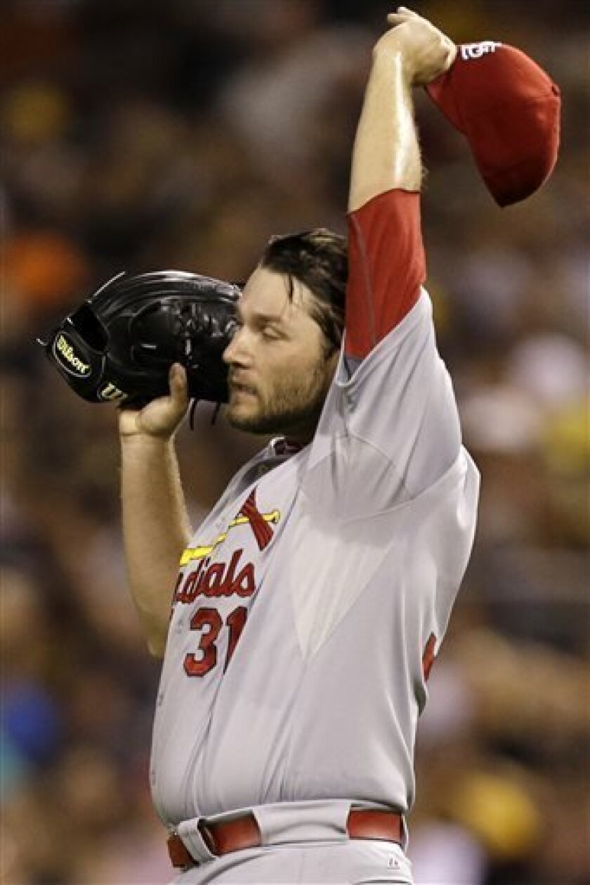 St. Louis Cardinals starting pitcher Lance Lynn (31) wipes his head after giving up a three-run home run to Pittsburgh Pirates' Russell Martin during the third inning of a baseball game against the Pittsburgh Pirates in Pittsburgh Saturday, Aug. 31, 2013. (AP Photo/Gene J. Puskar)