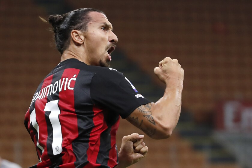 FILE - In this Sept. 21, 2020 file photo, AC Milan's Zlatan Ibrahimovic reacts during the Serie A soccer match between AC Milan and Bologna at the San Siro stadium, in Milan, Italy. It will be a strange atmosphere at San Siro when Inter Milan hosts city rival AC Milan on Saturday with only 1,000 fans allowed in because of the coronavirus pandemic. One player who is almost certain to be on the field is Milan forward Zlatan Ibrahimović, who returned to training this week after recovering from the virus. (AP Photo/Antonio Calanni)