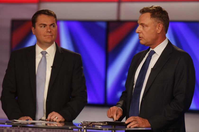 Rep. Scott Peters (D-San Diego), right, faced a tough reelection challenge last year from Republican Carl DeMaio, left, during a 2014 debate with Peters.