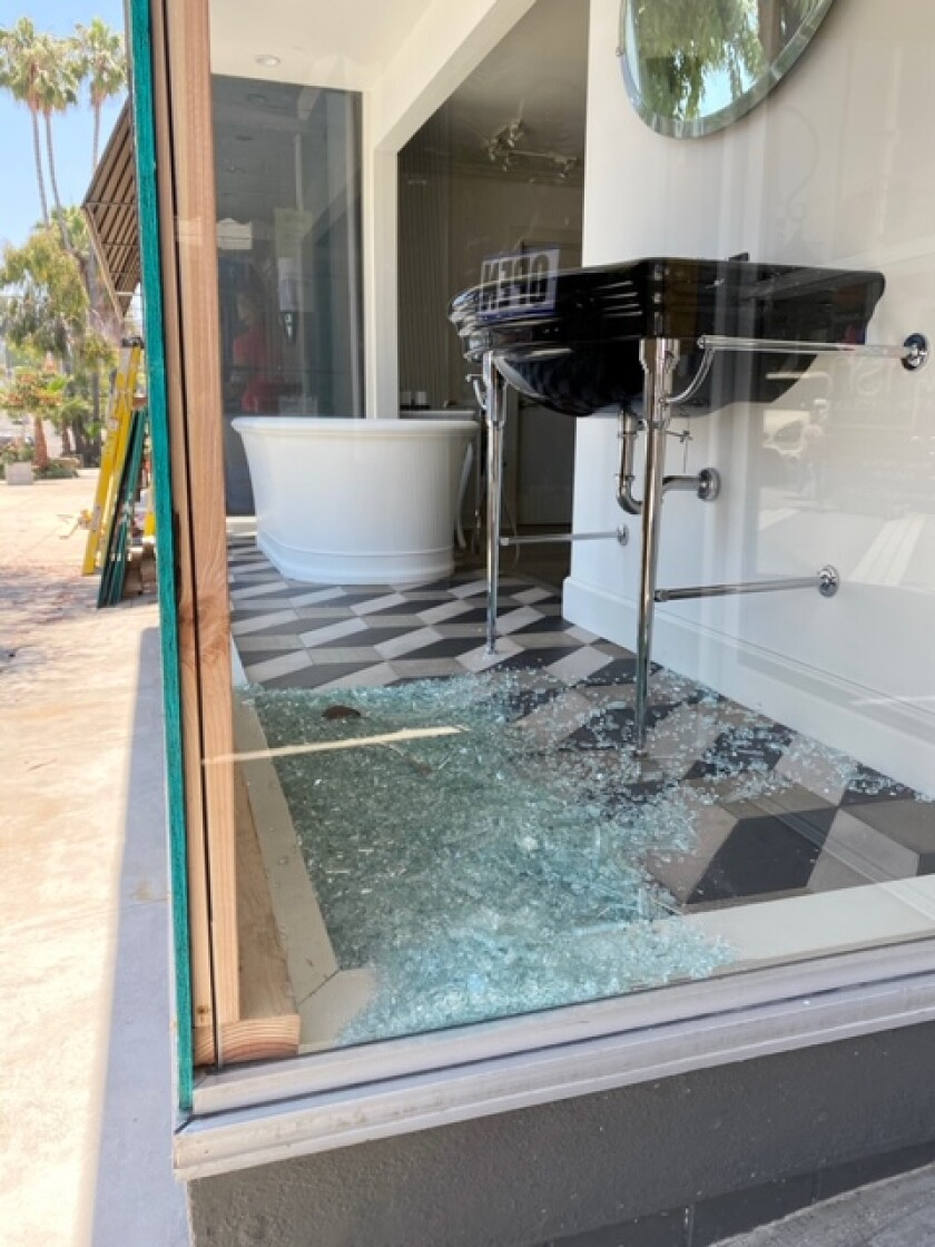 The front window of Lavish — The Bath Gallery at 7644 Girard Ave. in La Jolla was smashed by a vandal.