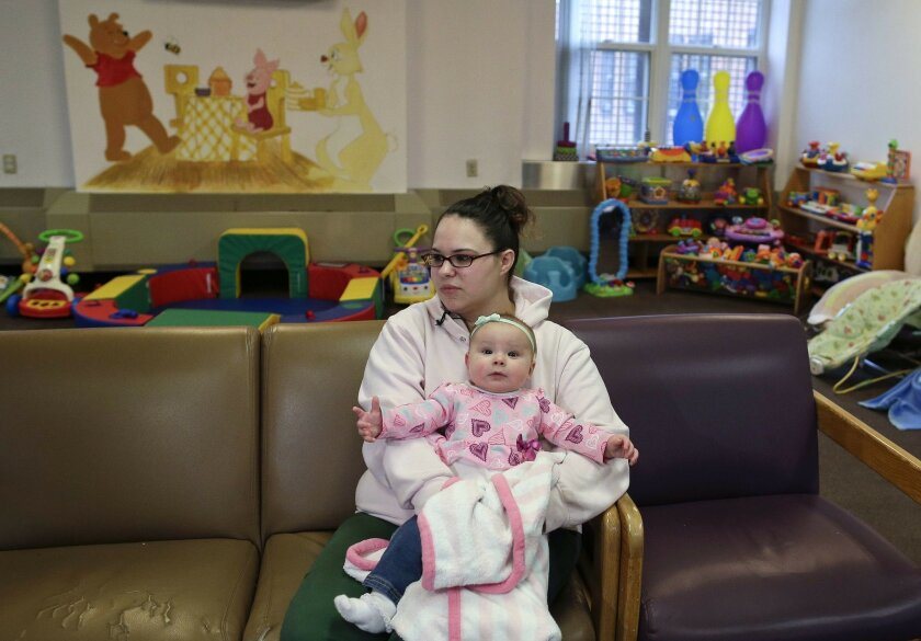 In this April 12, 2016 photo, Jennifer Dumas answers questions during an interview while holding her daughter, Codylynn, in a playroom at Bedford Hills Correctional Facility, in Bedford Hills, N.Y. Bedford Hills has one of only eight working prison nurseries where women live with their babies, out of more than 100 women's prisons around the country. (AP Photo/Julie Jacobson)