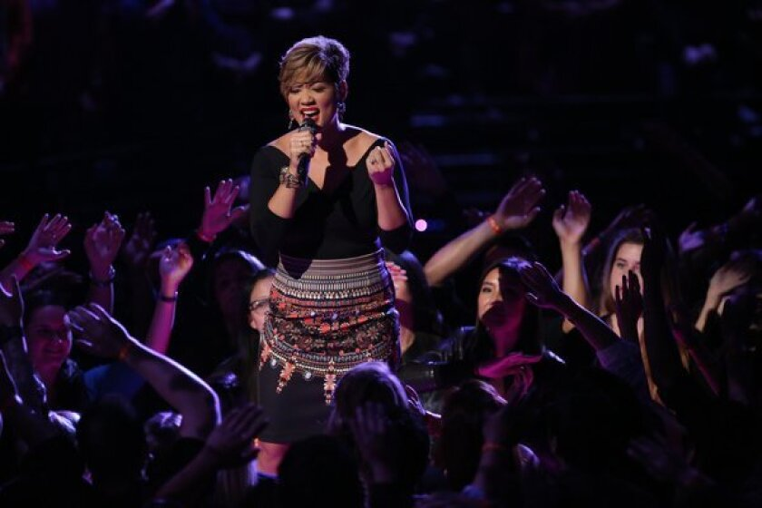 "Contestant Tessanne Chin performs live on ""The Voice."""