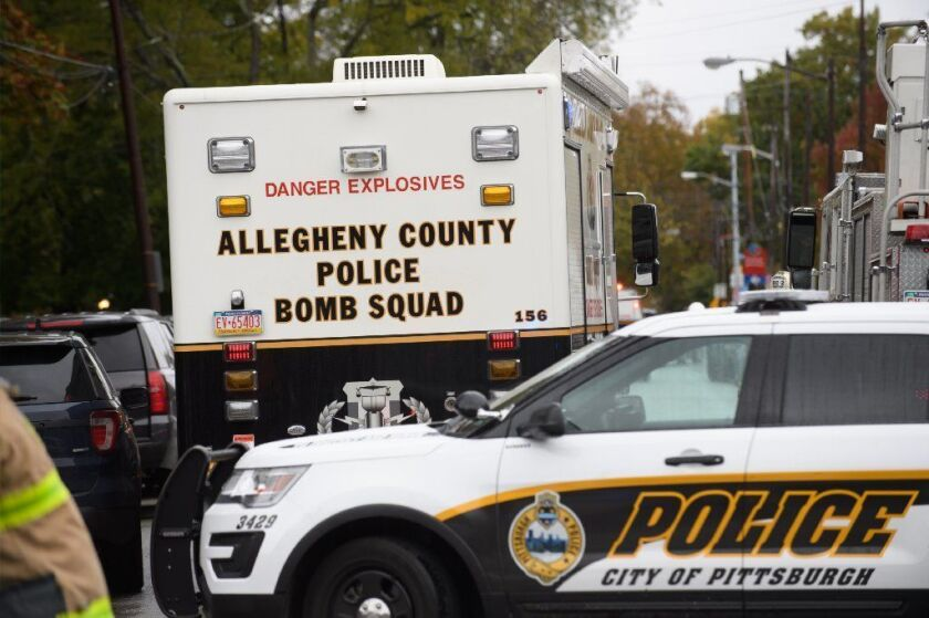 Police respond to the site of a mass shooting at the Tree of Life Synagogue in the Squirrel Hill neighborhood of Pittsburgh.