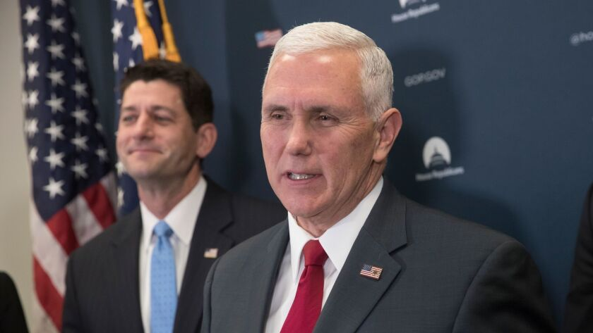 Smirking won't solve the problem: House Speaker Paul Ryan (R-Wis.), left, and Vice President-elect Mike Pence emerge from a meeting Wednesday to discuss a strategy to repeal Obamacare.