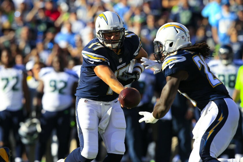 In the 1st half against Seattle Seahawks, Philips Rivers hands off to Melvin Gordon.