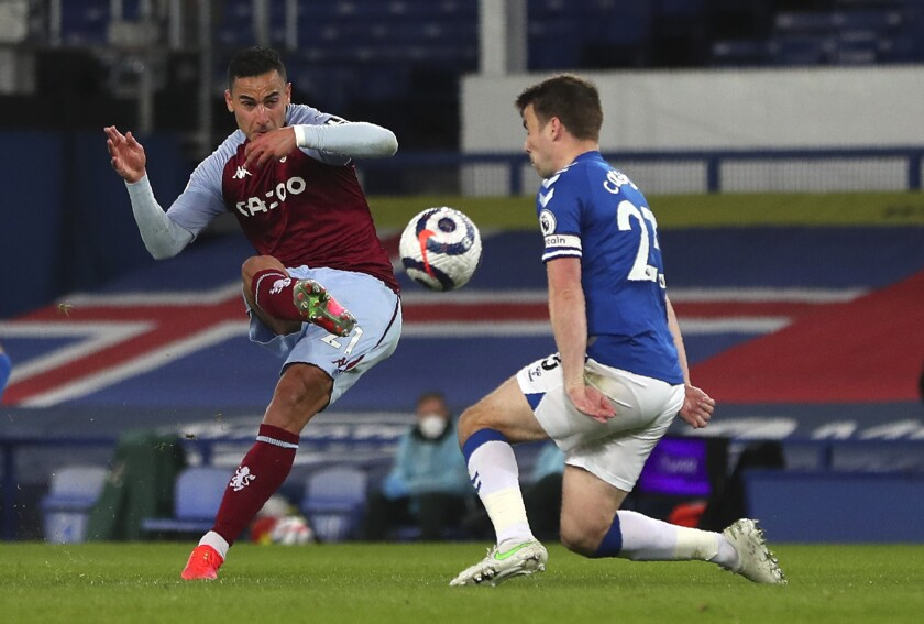Aston Villa's Anwar El Ghazi scores his side's second goal during the English Premier League soccer match between Everton and Aston Villa at Goodison Park in Liverpool, England, Saturday, May 1, 2021. (Peter Byrne/Pool via AP)