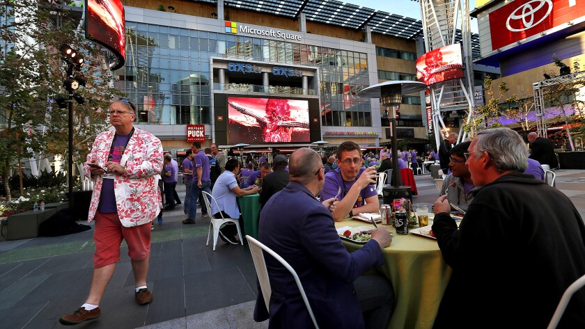 Employees with Ribbon Communications, a global technology company, dine in the courtyard at L.A. LIv