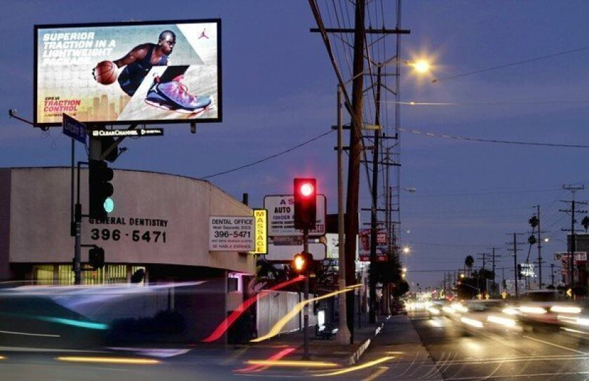"""A Venice resident says this digital billboard on Lincoln Boulevard shines into her room. Councilmen Ed Reyes and Paul Krekorian say a new deal could bring the city a """"significant"""" chunk of digital billboard revenue."""