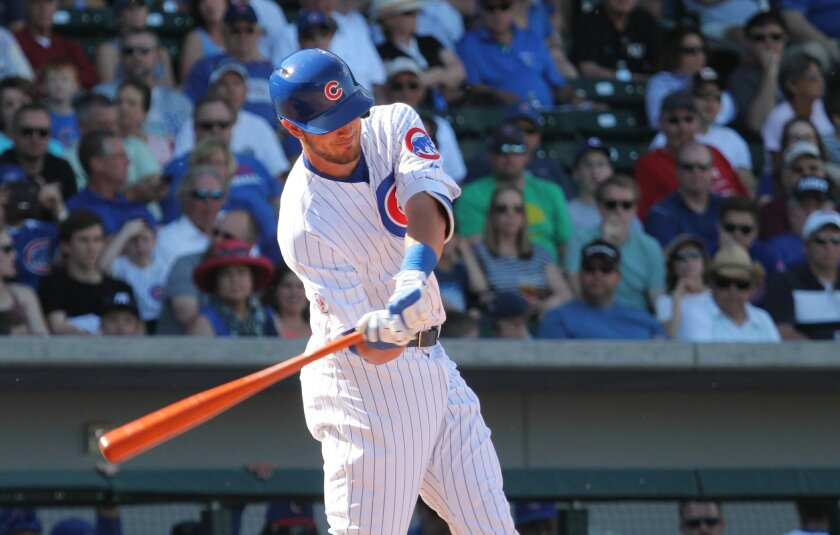 Chicago Cubs infielder Kris Bryant swings and hits a fly ball to right field that drops in for a single against the San Diego Padres.