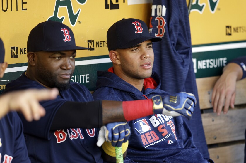 Yoan Moncada, right, sits beside David Ortiz in the Boston Red Sox dugout on Sept. 2.