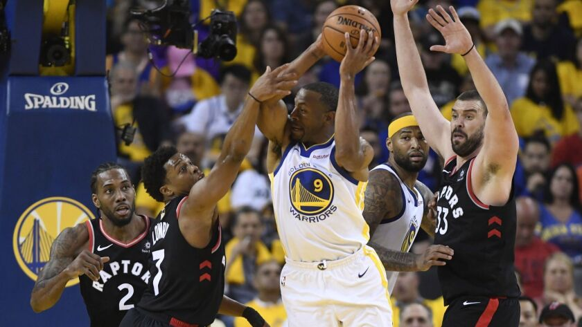 Golden State Warriors forward Andre Iguodala (9) controls the ball as Toronto Raptors guard Kyle Low