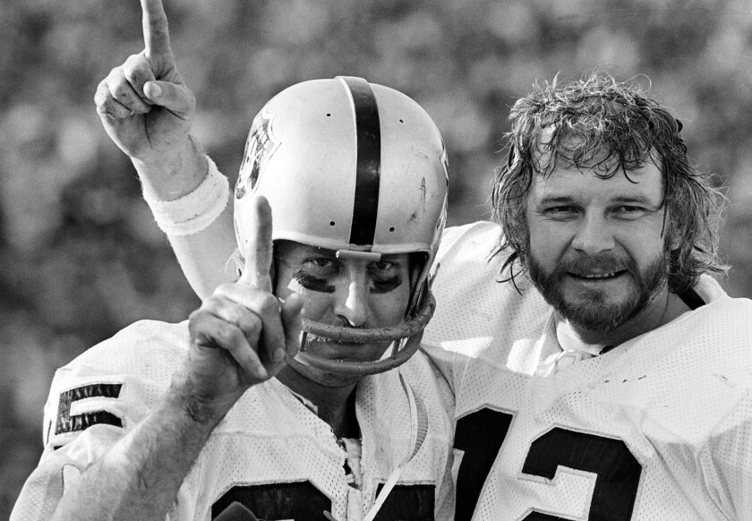 Oakland Raiders receiver Fred Biletnikoff and quarterback Ken Stabler, right, each hold up one finger after defeating the Minnesota Vikings in Super Bowl XI on Jan. 9, 1977.