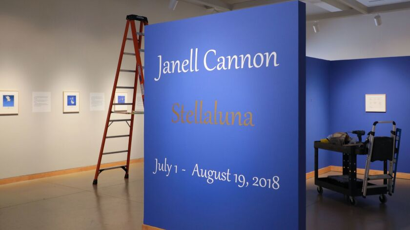 """The name of artist Janell Cannon is displayed with """"Stellaluna,"""" the name of her best selling children's book at a show of her book's illustrations at Carlsbad Library's gallery."""