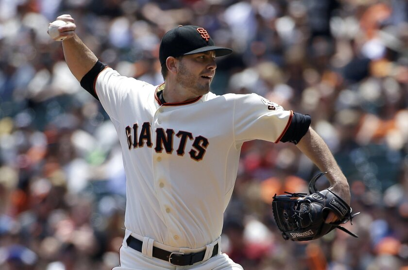 San Francisco Giants pitcher Chris Heston throws against the Philadelphia Phillies during the first inning of a baseball game in San Francisco, Sunday, July 12, 2015. (AP Photo/Jeff Chiu)