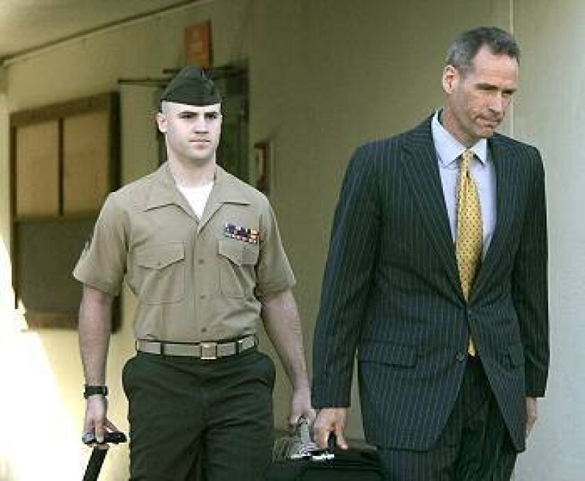 Civilian Defense Counsel Paul Hackett (right) leads Marine Sgt. Ryan Weemer into court for the start of Weemer's court-martial at Camp Pendleton.