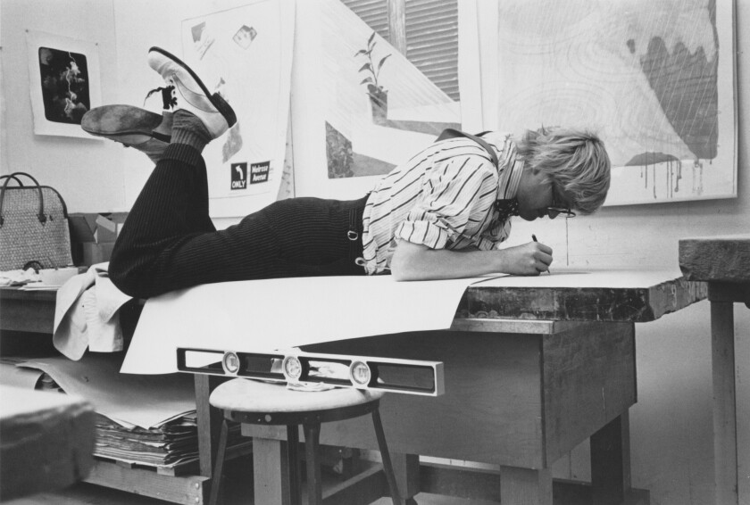 """David Hockney draws on a lithograph stone for his """"Weather Series"""" at Gemini G.E.L. in 1973."""