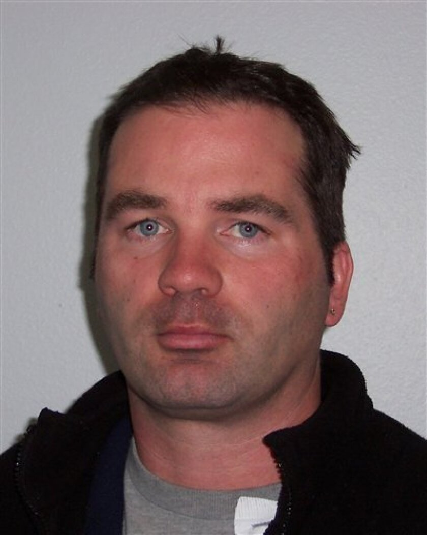 This photo provided by Pierce County sheriff's office, Tony Barrett is shown.   Barrett called a TV station newsroom saying he killed his wife and asking to post that message on Facebook set off a search that resulted in his arrest after a high-speed chase and the discovery of his wife's body in a
