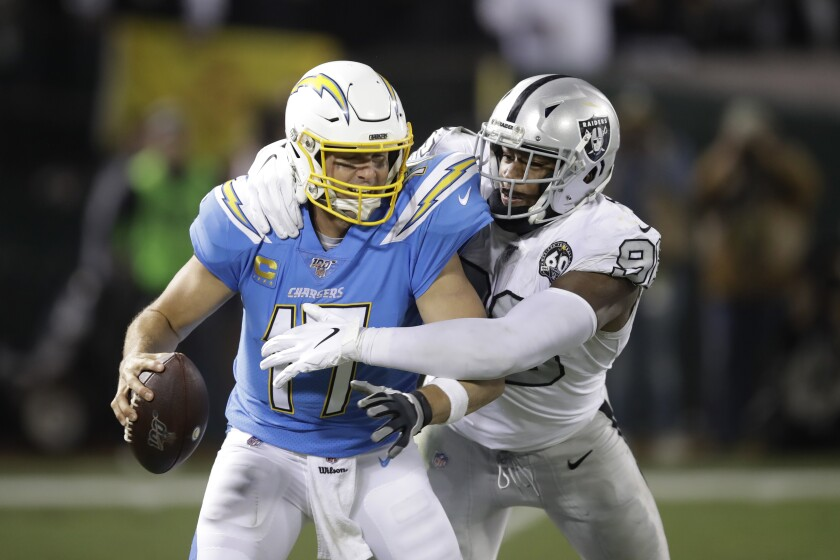 Chargers quarterback Philip Rivers is sacked by Oakland Raiders defensive end Clelin Ferrell during the second half.