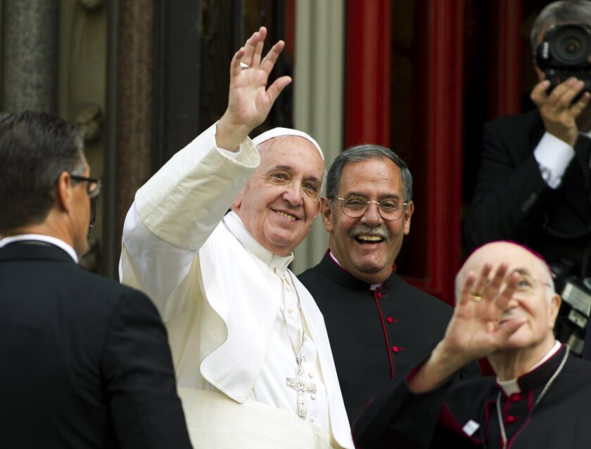 Pope Francis waves to the crowd upon his arrival at St. Patrick's Church in Washington on Thursday, Sept. 24.