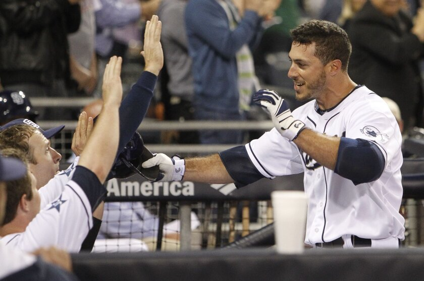 The Padres' Tommy Medica celebrates with teammates after he hit a home run in the second inning.