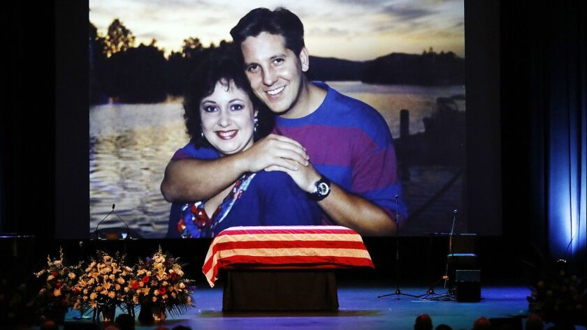A family photo of slain Ventura County Sheriff's Sgt. Ron Helus with his wife, Karen, is shown during a memorial service for Helus.