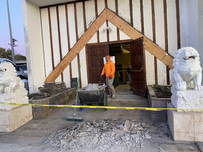 Workers slowly bring the Mandarin House back to life at 6765 La Jolla Blvd.