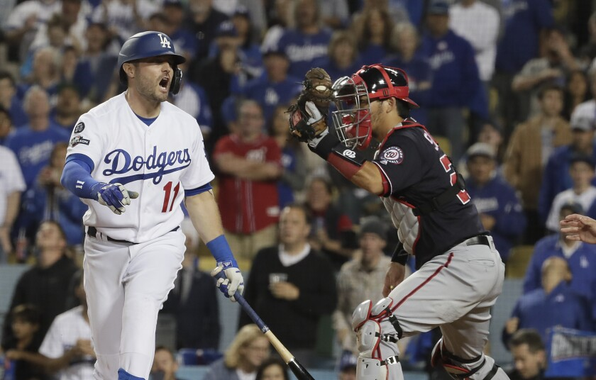 Dodgers center fielder A.J. Pollock reacts after striking out in the ninth inning.