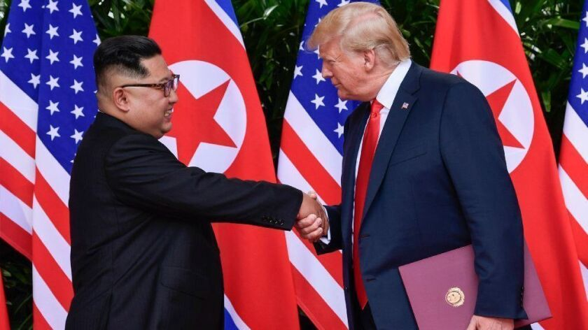 North Korean leader Kim Jong Un and President Trump shake hands at the conclusion of their meeting in Singapore on June 12, 2018.