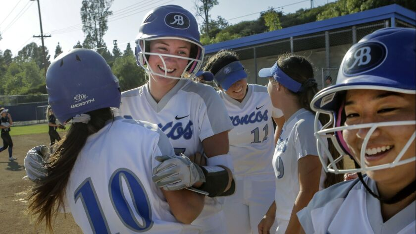 Rancho Bernardo junior Allie Boaz (second from left) cheers her game-winning homer to open the playoffs.