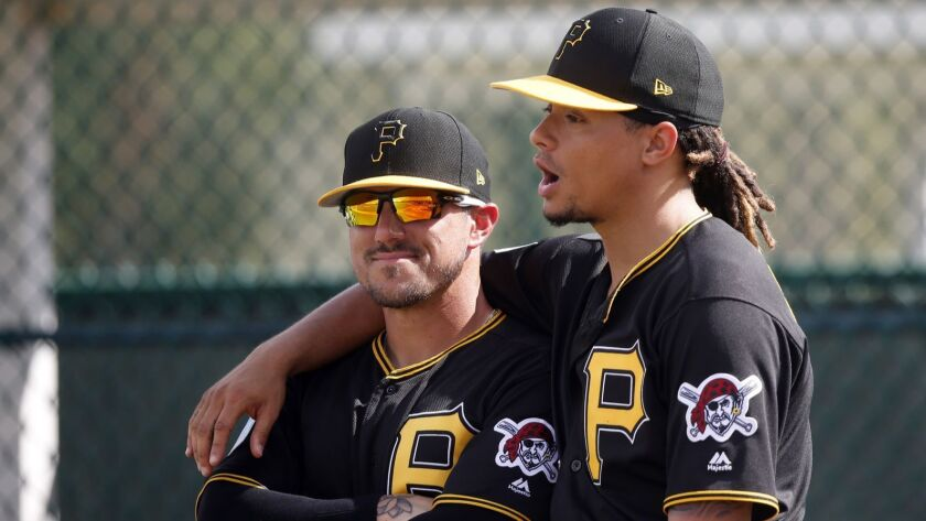Pittsburgh Pirates bullpen catcher Jordan Comadena, left, smiles with pitcher Chris Archer at their
