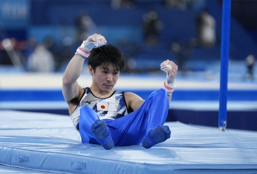 Kohei Uchimura, of Japan, falls from the horizontal bar during the men's artistic gymnastic qualifications at the 2020 Summer Olympics, Saturday, July 24, 2021, in Tokyo. (AP Photo/Natacha Pisarenko)