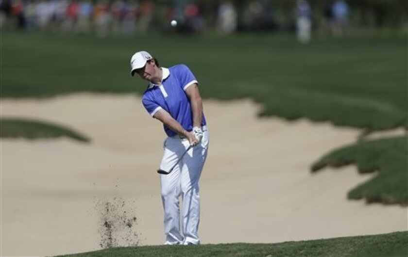 Rory McIlroy, of Northern Ireland, chips to the green on the 14th hole during the final round of the Texas Open golf tournament on Sunday, April 7, 2013, in San Antonio. McIlroy finished second. (AP Photo/Eric Gay)