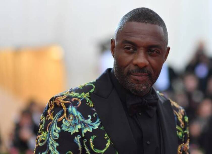 """English actor Idris Elba arrives for the 2019 Met Gala at the Metropolitan Museum of Art on May 6, 2019, in New York. - The Gala raises money for the Metropolitan Museum of Arts Costume Institute. The Gala's 2019 theme is Camp: Notes on Fashion"""" inspired by Susan Sontag's 1964 essay """"Notes on Camp"""". (Photo by ANGELA WEISS / AFP) (Photo credit should read ANGELA WEISS/AFP/Getty Images)"""