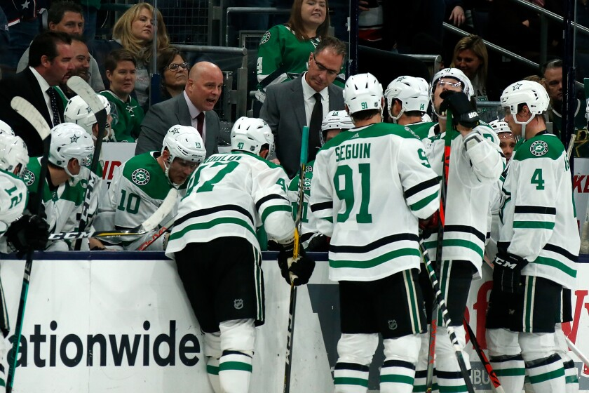 Dallas Stars coach Jim Montgomery talks to his players during a timeout in a game against the Columbus Blue Jackets on Oct. 16.