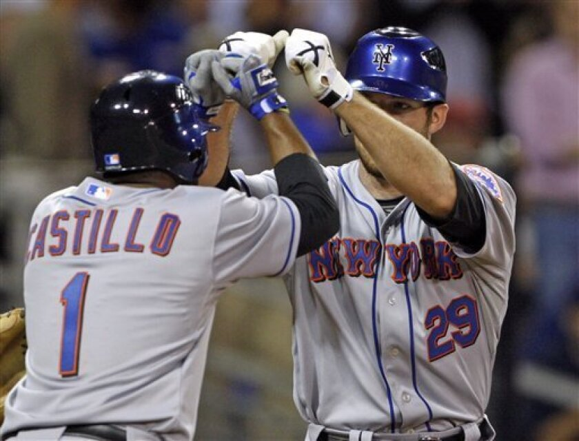 New York Mets' Ike Davis is greeted by Luis Castillo after his two run homer in the seventh inning against the San Diego Padres in a baseball game Tuesday June 1, 2010 in San Diego. (AP Photo/Lenny Ignelzi)
