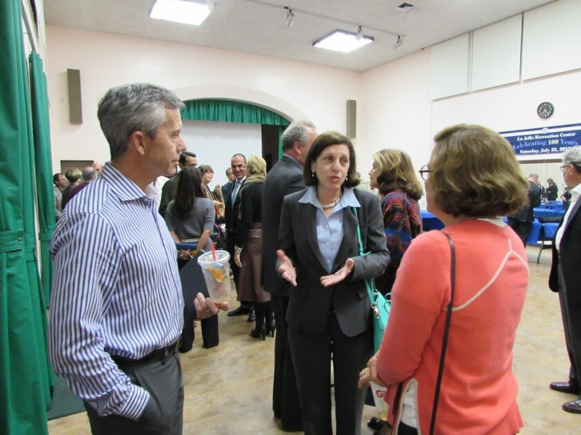 La Jollan Barbara Bry (center), who confirmed her intention to run for the District 1 San Diego City Council seat to be vacated by Sherri Lightner at the end of 2016, speaks with La Jolla Parks & Beaches members Patrick Ahern and Judy Adams Halter, who are driving a modern rebuild of the run-down r