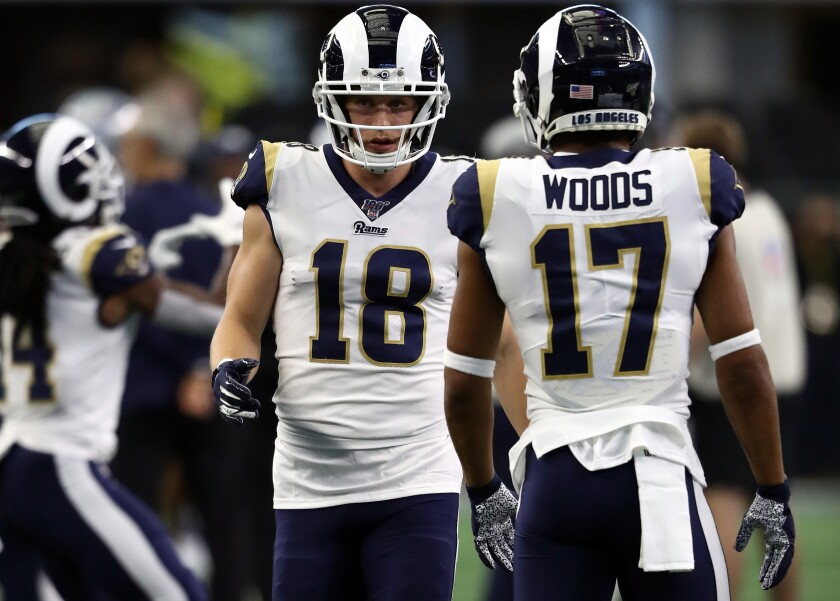 Rams receivers Cooper Kupp (18) and Robert Woods (17) warm up before a game against the Cowboys on Dec. 15 at AT&T Stadium.