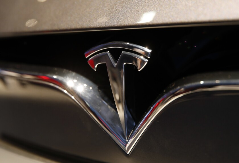 The logo of Tesla is pictured at the Auto show in Paris, France, Wednesday, Oct. 3, 2018, 2018. All-