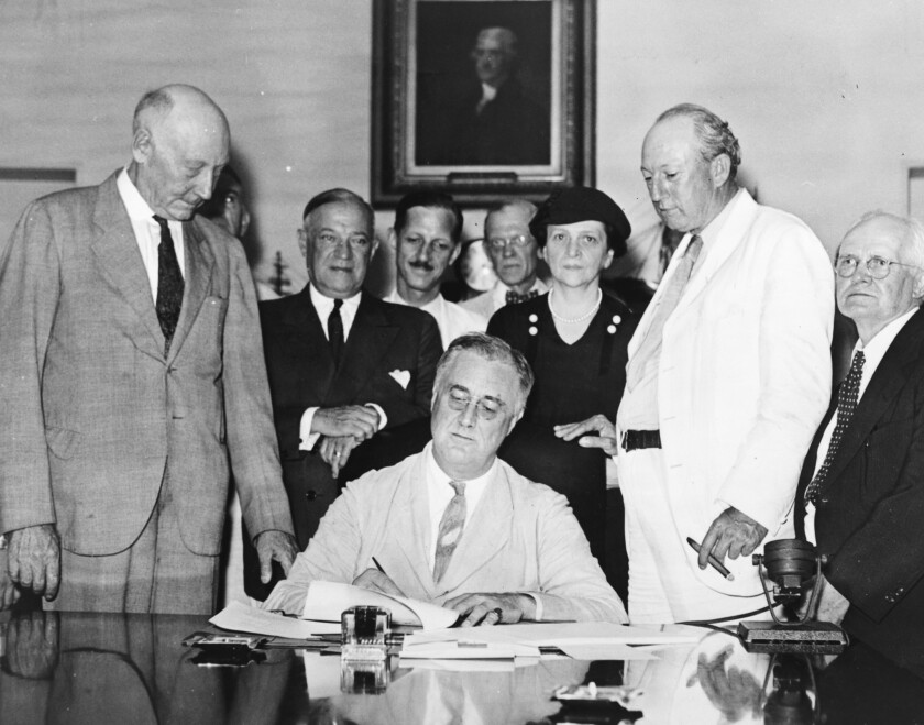 Happy Birthday, Social Security: FDR signs the Social Security Act on Aug. 14, 1935. Behind him (in dark suits) are progressive Sen. Robert Wagner (D-N.Y.) and Labor Secretary Frances Perkins, head of the committee that drafted the bill.