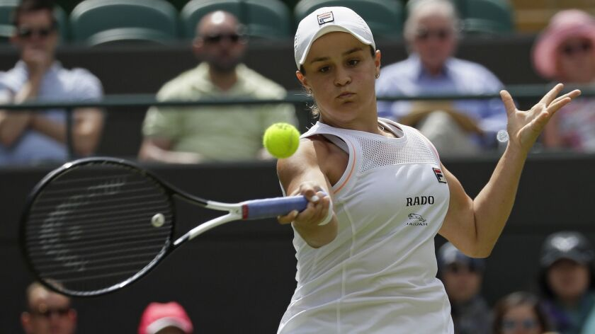 Australia's Ashleigh Barty returns to China's Saisai Zheng in their Women's singles match during day