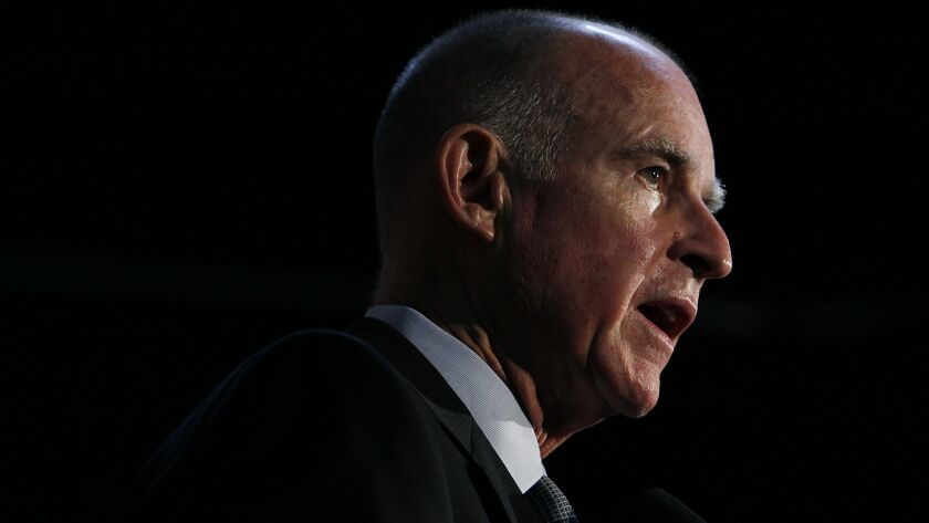 Jerry Brown talks with the media in Oakland, Calif. on Nov. 3, 2010.