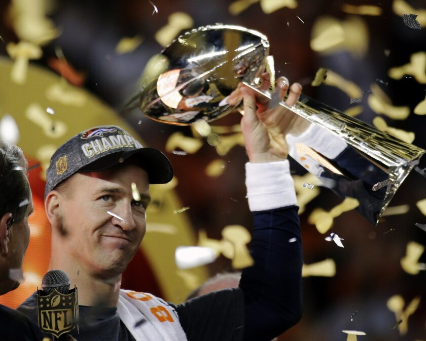 Denver Broncos quarterback Peyton Manning holds up the Lombardi Trophy after Super Bowl 50. The Broncos won 24-10.