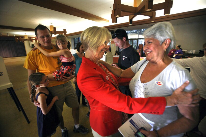 Rep. Janice Hahn greets Rosemary Mossbarger, right, at the Little Sisters of the Poor auditorium in San Pedro after Mossbarger cast her vote. Hahn ran five years ago and was reelected in 2012.
