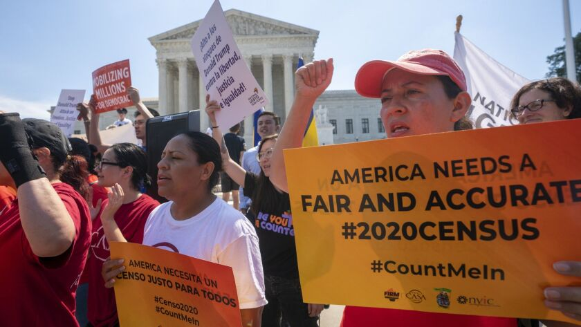 Demonstrators gather at the Supreme Court ahead of a decision on adding a citizenship question to the 2020 census on June 27.