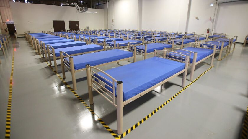 Beds in the new interim homeless shelter, The Link, in Santa Ana.