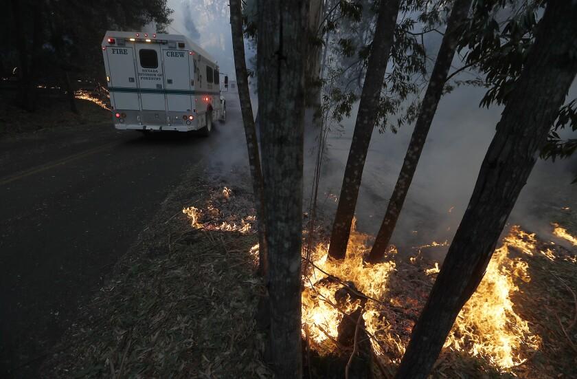 Spot fires within the Kincade fire line Chalk Hill Road near Healdsburg, Calif., on Sunday.