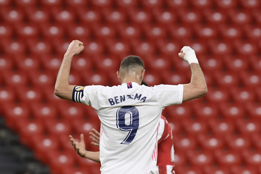 Real Madrid's Karim Benzema, celebrates the first goal of his team during Spanish La Liga soccer match between Athletic Bilbao and Real Madrid at San Mames stadium, in Bilbao, northern Spain, Sunday, May 16, 2021. (AP Photo/Alvaro Barrientos)