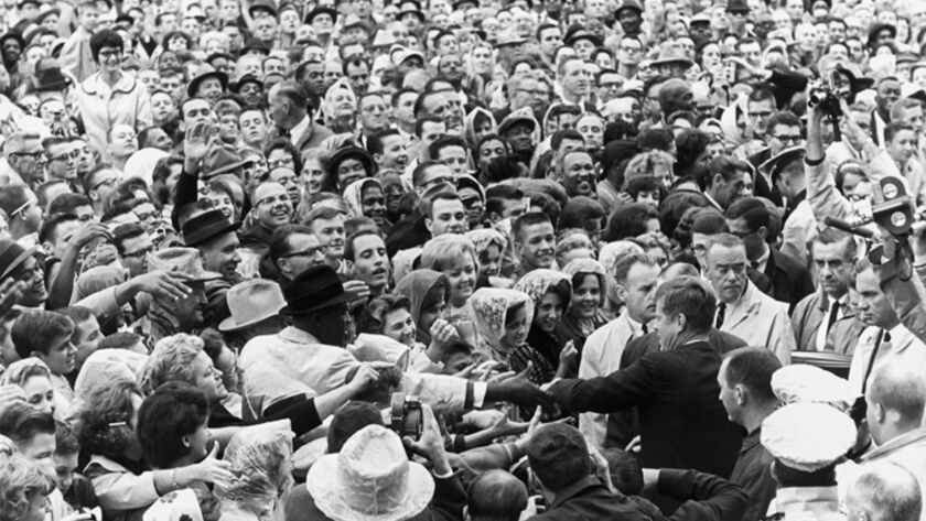 President John F. Kennedy greets a large crowd at a rally in Fort Worth, Texas, on the morning of Nov. 22, 1963, the day of his assassination. Museums and libraries across the country are marking Kennedy's 100th birthday.