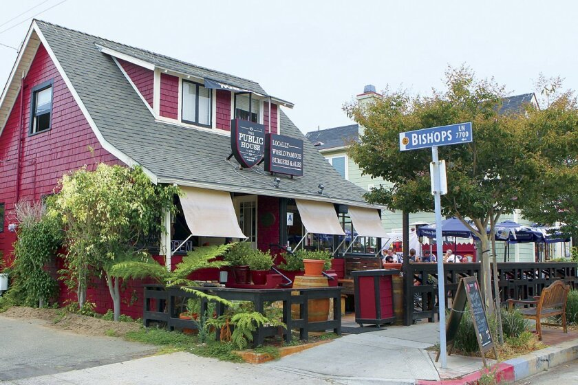The two-story, red house on the corner of Kline Street and Bishops Lane in the Village of La Jolla was first built in 1904 and has been designated as a historical landmark. It has been occupied by The Public House bar and restaurant since 2011. Photo by Daniel K. Lew